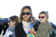 Jessica Abla, her husband Cash Warren and their daugther Honor arrive at LAX airport to catch a flight to Cabo San Lucas to ring in the new year.