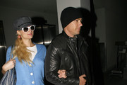 Socialite Paris Hilton and her boyfriend Cy Waits arrive on a flight from Maui at LAX airport in Los Angeles.