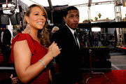 Singer/actress Mariah Carey (L) and singer Nick Cannon arrive at the 16th Annual Screen Actors Guild Awards held at the Shrine Auditorium on January 23, 2010 in Los Angeles, California.