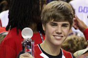Justin Bieber celebrates at the 2011 BBVA NBA All-Star Celebrity Game at Los Angeles Convention Center on February 18, 2011 in Los Angeles, California.
