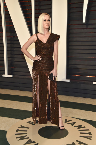 Katy Perry in an Asymmetrical Bronze Gown