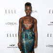 Lupita Nyong'o in Gilded Ruse and Turquoise