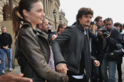 Miranda Kerr and Orlando Bloom depart from the Balenciaga Ready to Wear Spring/Summer 2011 show during Paris Fashion Week on September 30, 2010 in Paris, France.