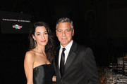 Amal Alamuddin and George Clooney attend the Celebrity Fight Night In Italy Benefitting The Andrea Bocelli Foundation and The Muhammad Ali Parkinson Center Gala on September 7, 2014 in Florence, Italy.