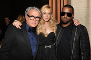 (L-R) Designer Giuseppe Zanotti, actress Lindsay Lohan and Kanye West attend the Giuseppe Zanotti Design Beverly Hills Store Opening dinner held at BOA Sunset on February 4, 2011 in West Hollywood, California.