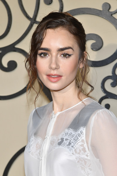 Lily Collin's Messy Chic Tendrils at the Givenchy Fashion Show