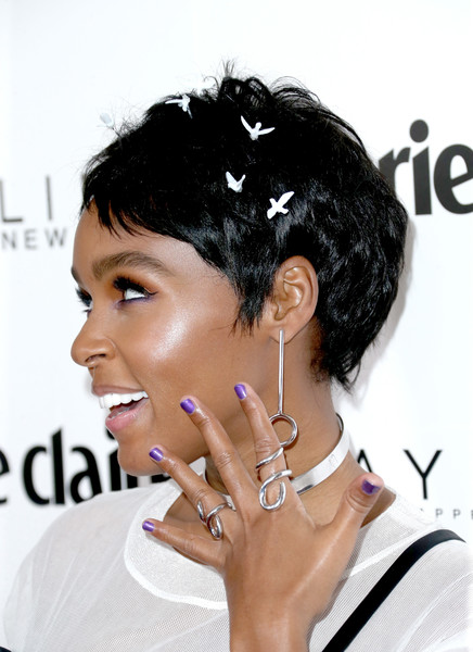 Fluttering Away With A Bird-Embellished Pixie Cut