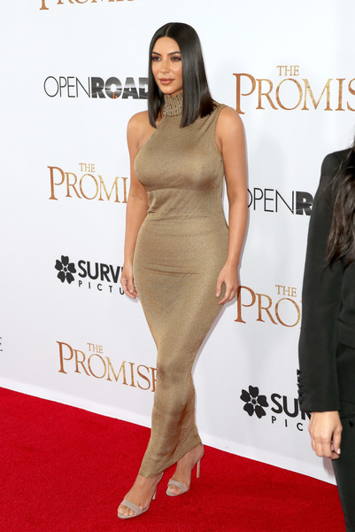 In Form-Fitting Gianni Versace Haute Couture At A Film Premiere