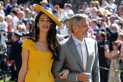 George Clooney and Amal Clooney arrive for the wedding ceremony of Britain's Prince Harry and US actress Meghan Markle at St George's Chapel, Windsor Castle on May 19, 2018 in Windsor, England.