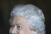 Queen Elizabeth II attends a reception for 603 (City of Edinburgh) Squadron, Royal Auxiliary Air Force, who have been honoured with the Freedom of The City of Edinburgh, at the Palace of Holyroodhouse on July 3, 2018 in Edinburgh, United Kingdom.
