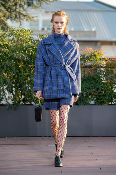 Chiara Boni at Milan Fall 2021 [footwear,outerwear,shoe,tartan,dress shirt,fashion,knee,neck,overcoat,waist,shoe,chiara boni,tartan,fashion,electric blue m,fashion model,coat,design,milan fashion week,fashion show,tartan,fashion show,electric blue m,shoe,coat,design,fashion,fashion model]