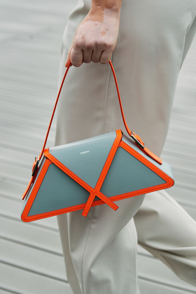 Coperni at Paris Spring 2021 (Details) [orange,bag,handbag,triangle,hand,textile,handbag,bag,dior,fashion,string bag,product design,coperni,hand,chanel,paris fashion week,handbag,chanel,paris fashion week,product design,fashion,dior,string bag,coperni,fashion week]