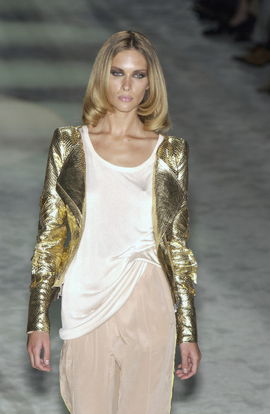 Gucci at Milan Spring 2004 [fashion model,fashion show,fashion,clothing,runway,shoulder,blond,long hair,haute couture,fashion design,leather jacket,fashion,runway,haute couture,jacket,fashion model,shoulder,gucci,milan fashion week,fashion show,runway,fashion,gucci,blazer,fashion show,jacket,haute couture,metallic leather jacket]