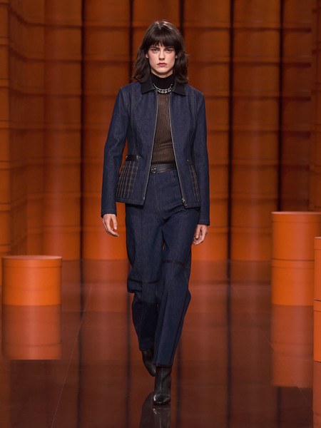 Hermès at Paris Fall 2021 [footwear,shoe,overcoat,sleeve,waist,orange,dress shirt,street fashion,knee,denim,jeans,shoe,denim,fashion,haute couture,suit,fashion model,hermes,paris fashion week,fashion show,fashion show,jeans,suit,shoe,fashion,haute couture,blazer,denim,fashion model,electric blue m]