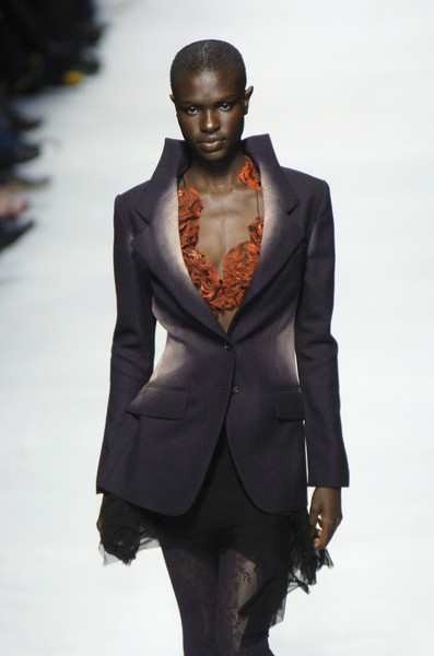 Issey Miyake at Paris Spring 2005 [suit,fashion,fashion model,clothing,fashion show,runway,formal wear,hairstyle,model,human,supermodel,issey miyake,fashion,runway,model,haute couture,suit,wear,paris fashion week,fashion show,fashion show,runway,model,fashion,supermodel,haute couture,tuxedo,tuxedo m.]