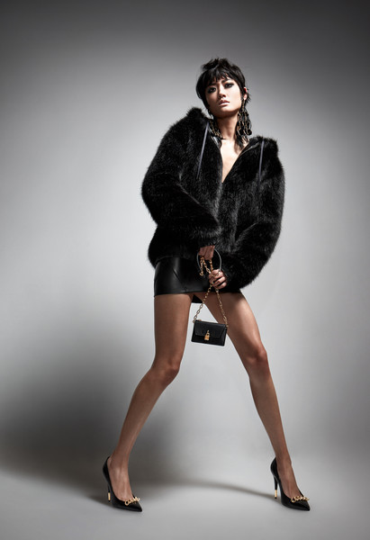 Tom Ford at New York Fall 2021 [shorts,dress,flash photography,neck,sleeve,waist,knee,thigh,black hair,fashion design,tom ford,fashion,vogue,fur clothing,clothing,model,coat,beauty,celebrity style,new york fashion week,fashion,vogue,celebrity style,fur clothing,clothing,model,coat,beauty,ready-to-wear,photo shoot]