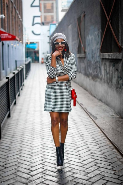 With a checkered coat dress and vibrant accessories.