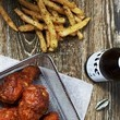 Eat A Basket Of Wings In An Alarmingly Messy Way