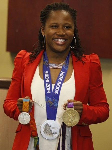 First Woman to Win a Medal in Both the Winter and Summer Olympics, 2014