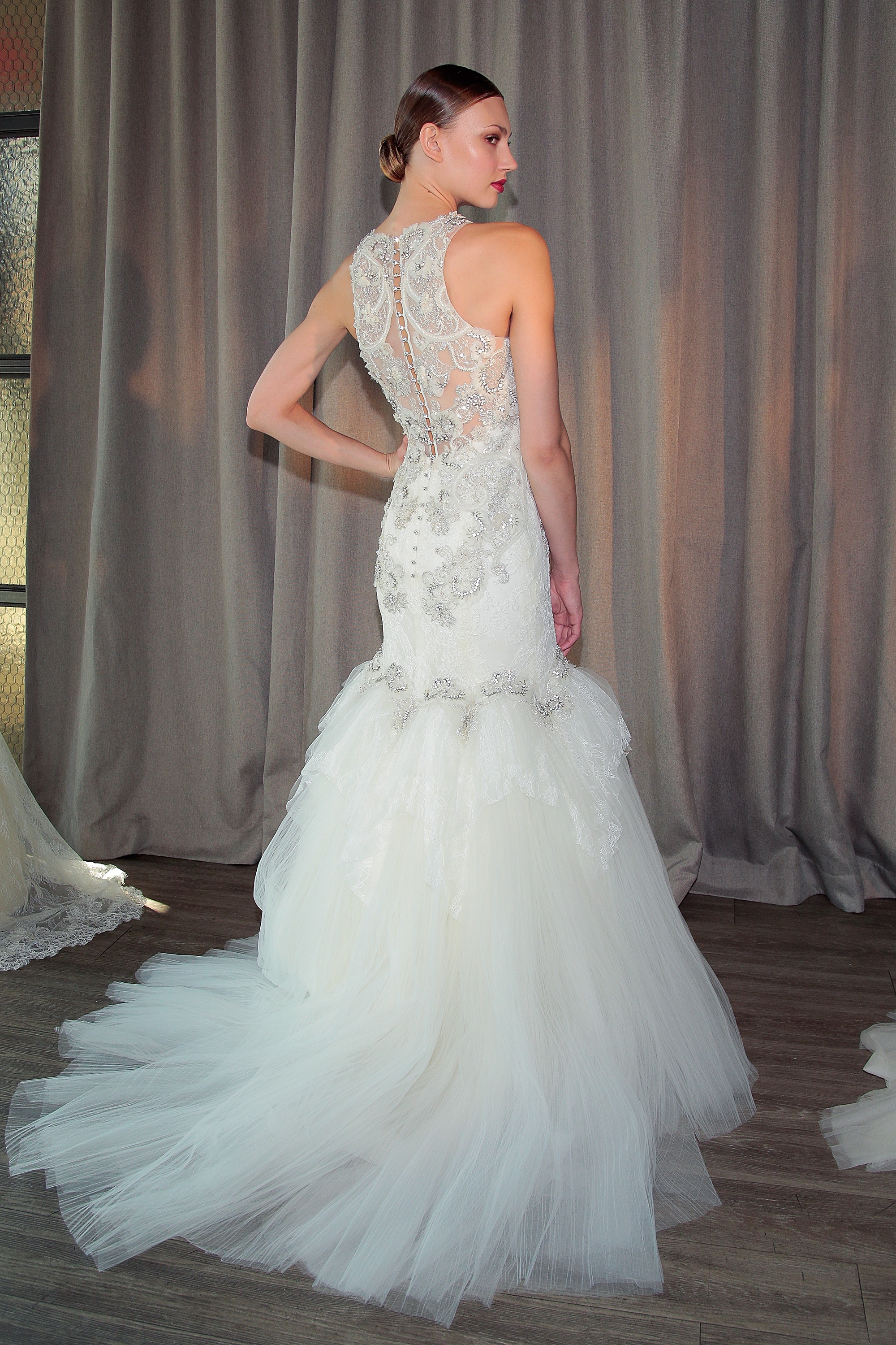 This Badgley Mischka gown stuns from behind with intricate lace detailing and crystal embellishments.