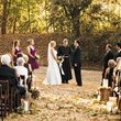 An outdoor ceremony with fallen leaves all around...swoon!