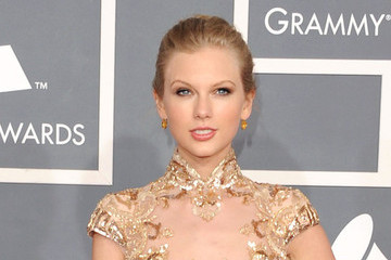 Taylor Swift Is Golden at the 54th Annual Grammy Awards