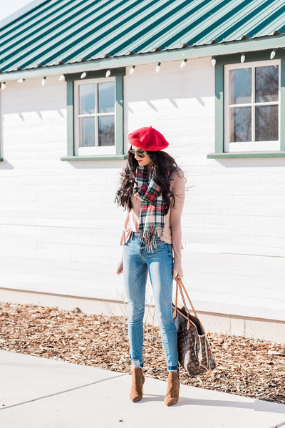 In bold red with matching lipstick and a plaid scarf.