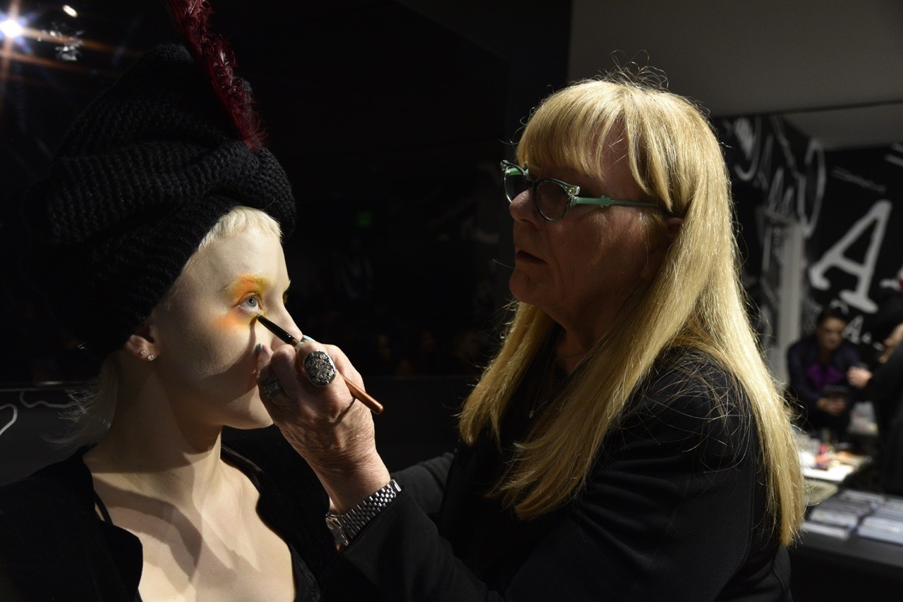 Ve curating a Capitol-inspired makeup look at the Hunger Games exhibit, using MAC Cosmetics.
