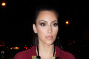 Kim Kardashian highlights her shapely figure in a plum-coloured frock. Kim  looked smitten as she arrived at BOA steakhouse with boyfriend Kris Humphries, a forward the the New Jersey Nets.