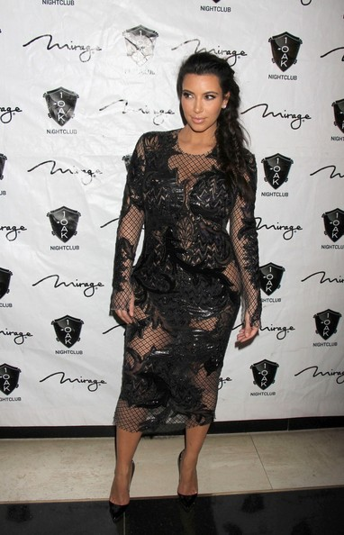 In A Black Net Maternity Dress At A NYE Event In Vegas