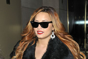 A glamorous Demi Lovato arriving at the