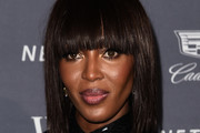 Naomi Campbell Medium Straight Cut with Bangs